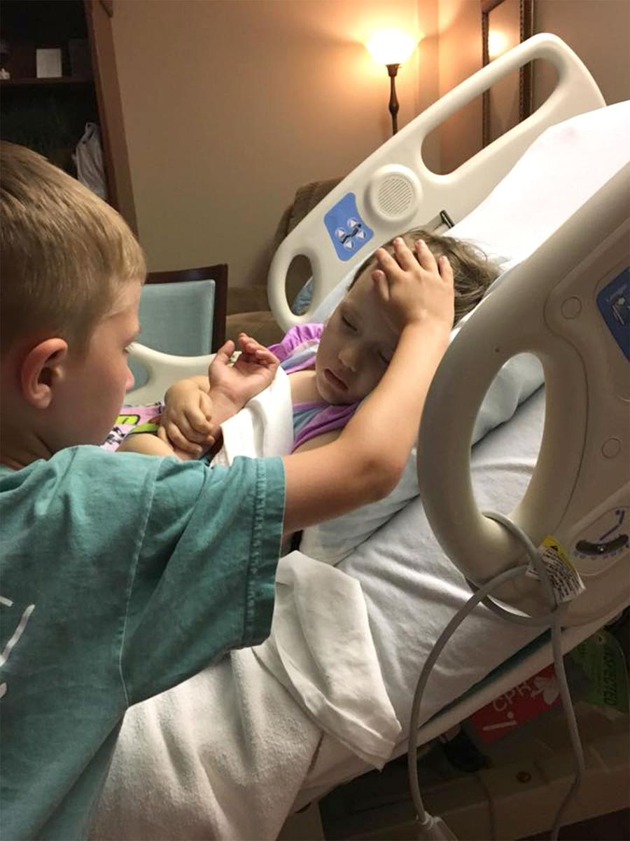 Grieving Dad Shares Photo of Son, 6, Comforting 4-Year-Old Sister Before Her Death