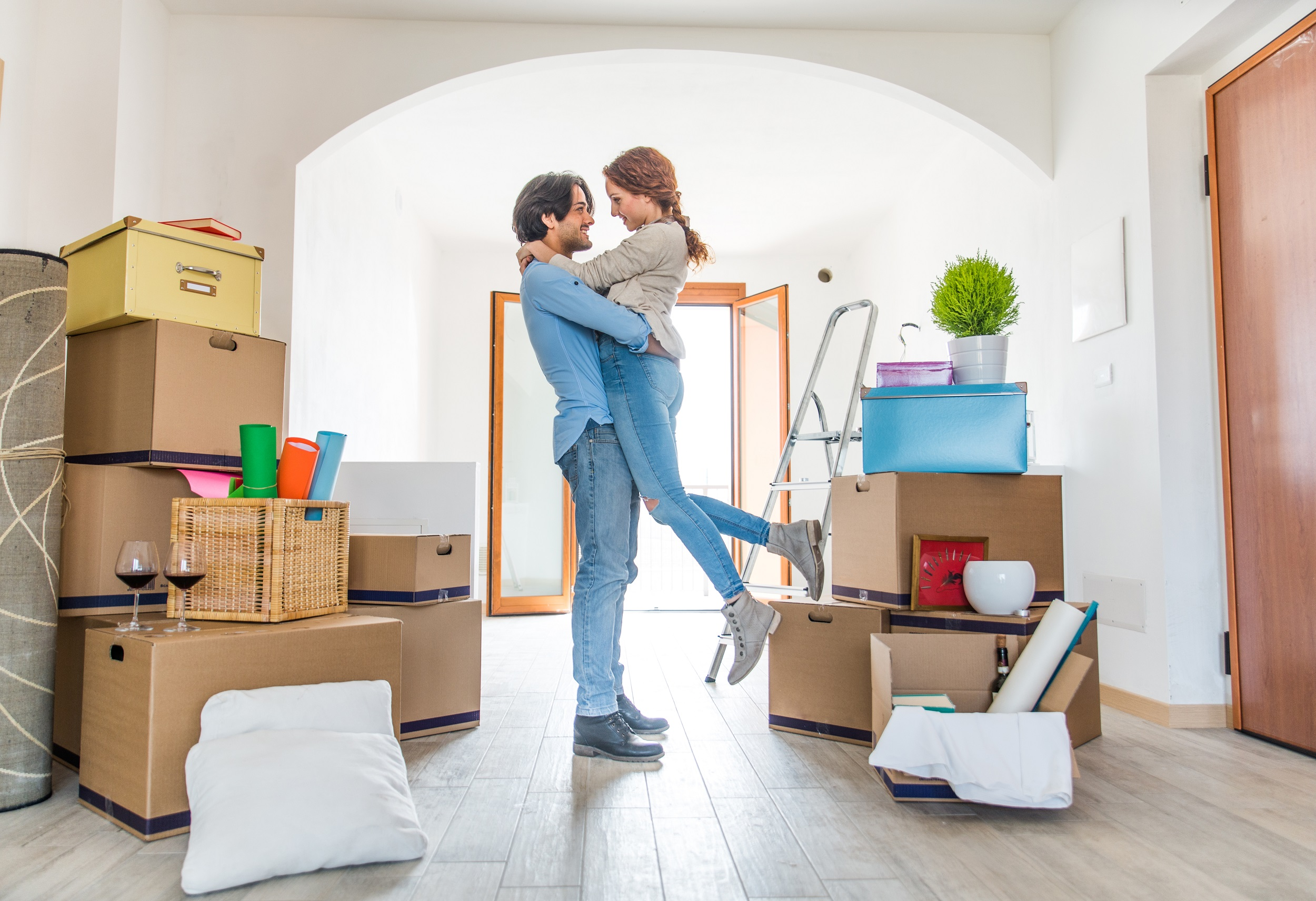 Happy Couple Moving In Home Man Carries Girl