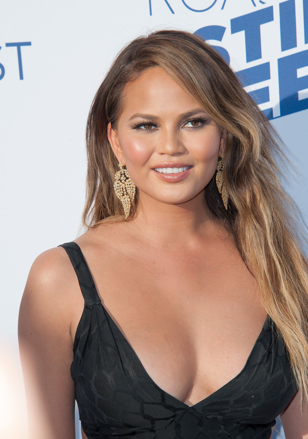 Chrissy Teigen Black Dress On Red Carpet