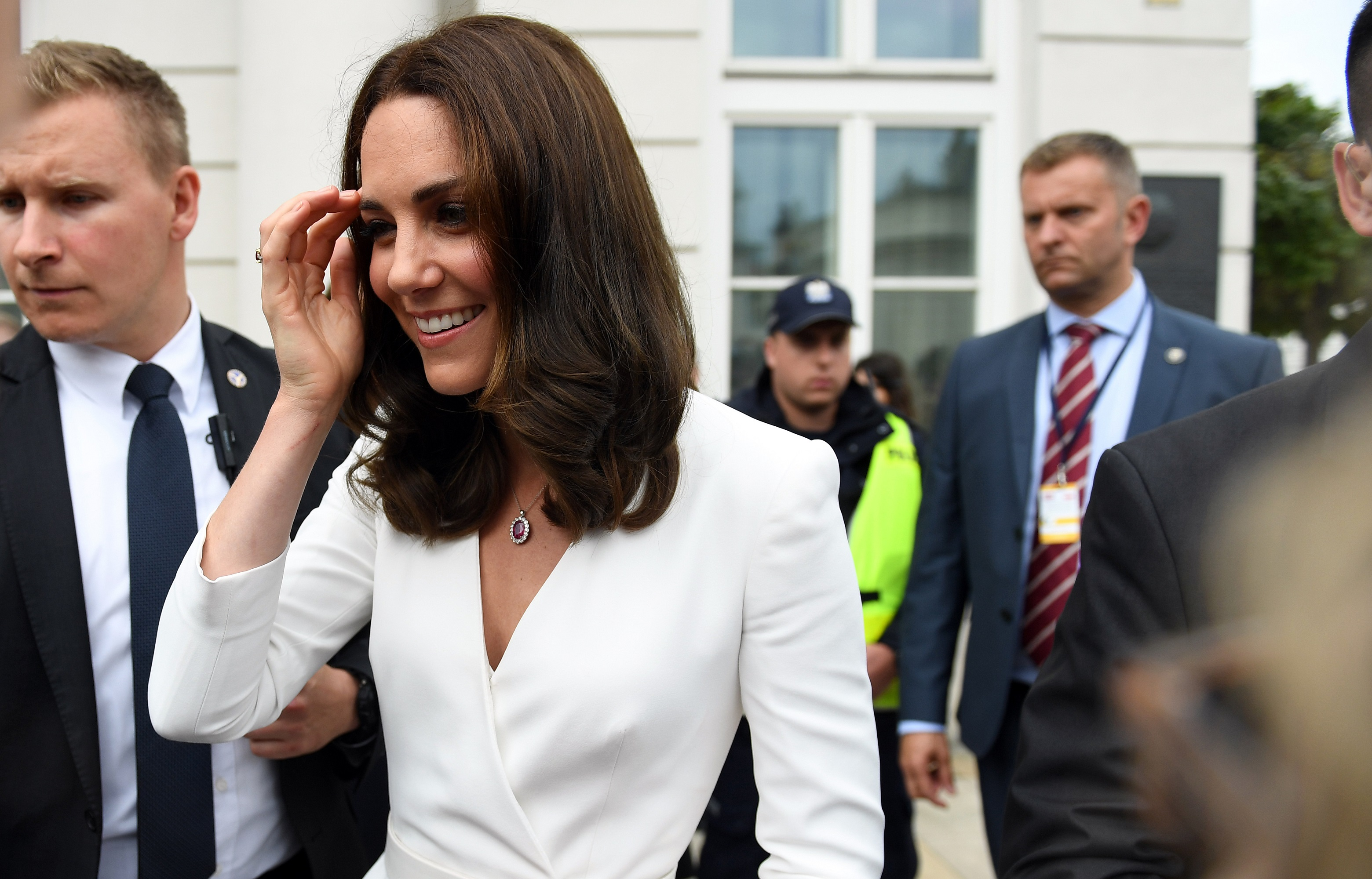 Kate Middleton White Dress Outside Surrounded By Bodyguards