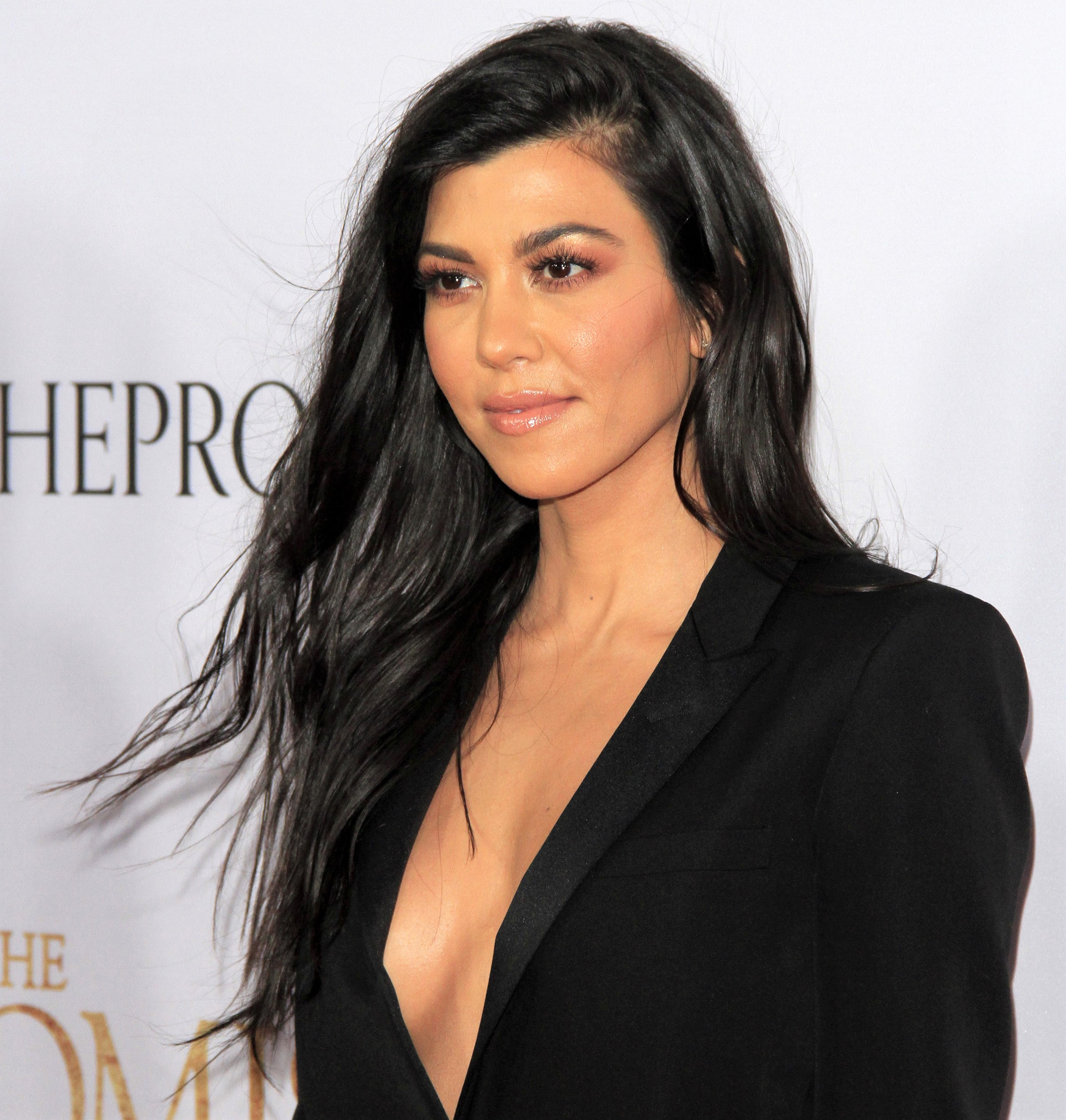 Kourtney Kardashian Flowy Hair Black Deep V Suit