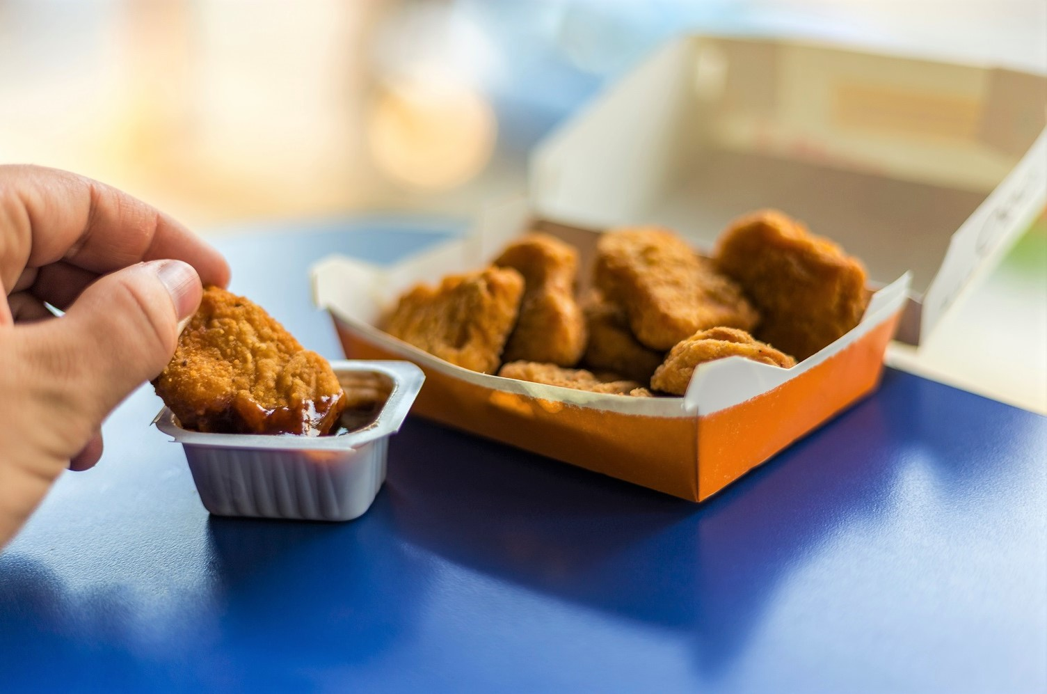 Fast Food Chicken Nuggets Dipped In Sauce
