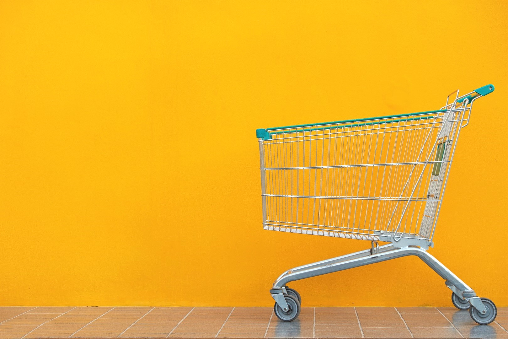 Shopping Cart Yellow Wall Background