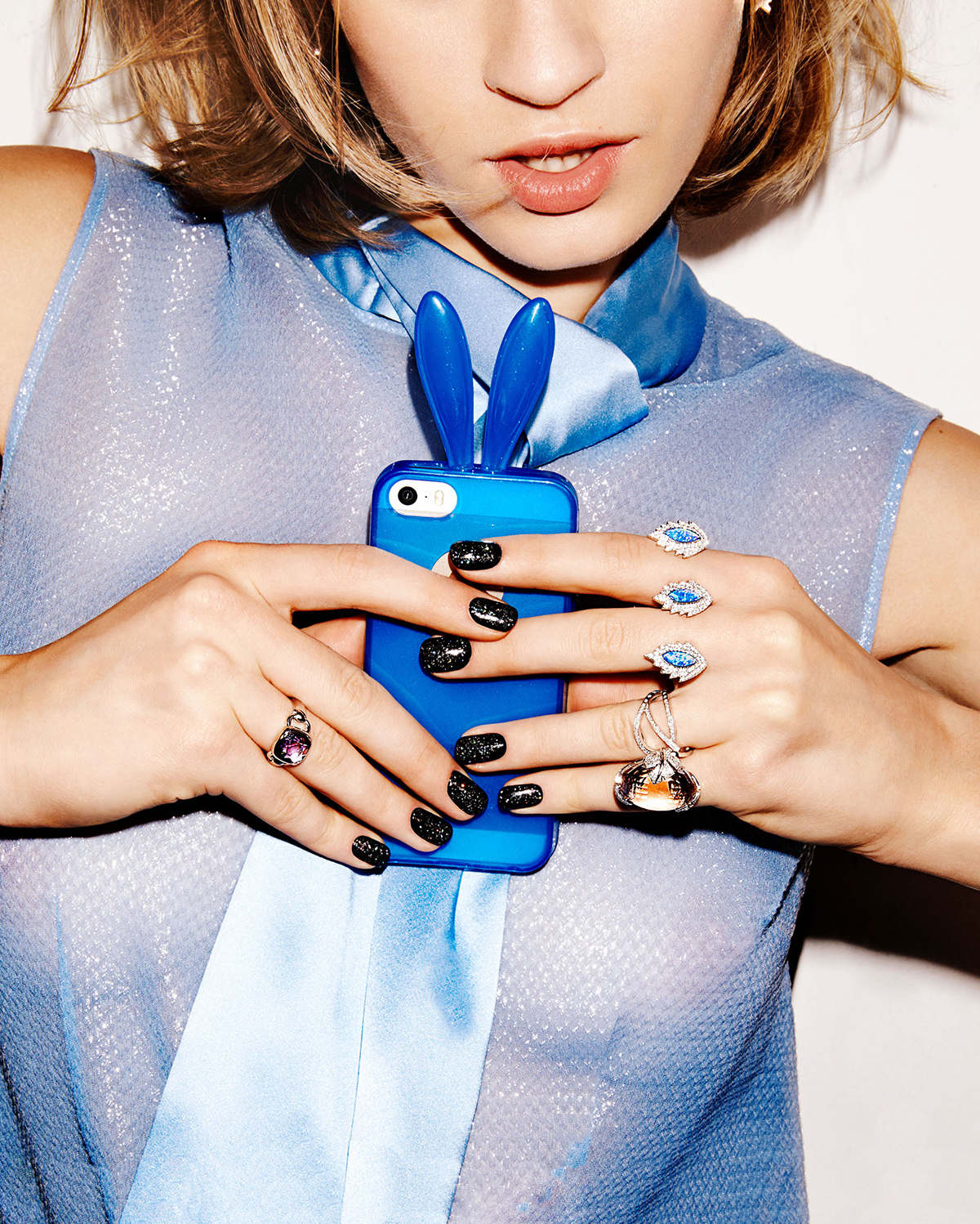 woman taking selfie with blue phone case