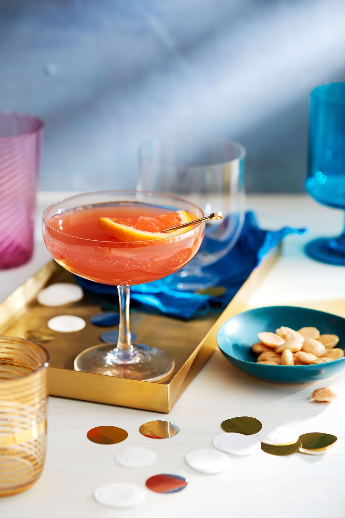 pomegranate mojito cocktail and party peanuts on table