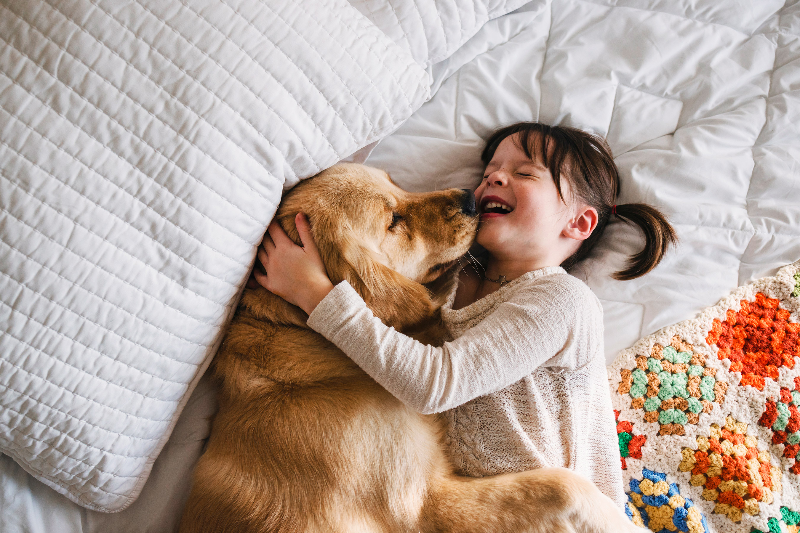 Want to Protect Your Kids from Allergies? Study Says Get a Dog... or Two