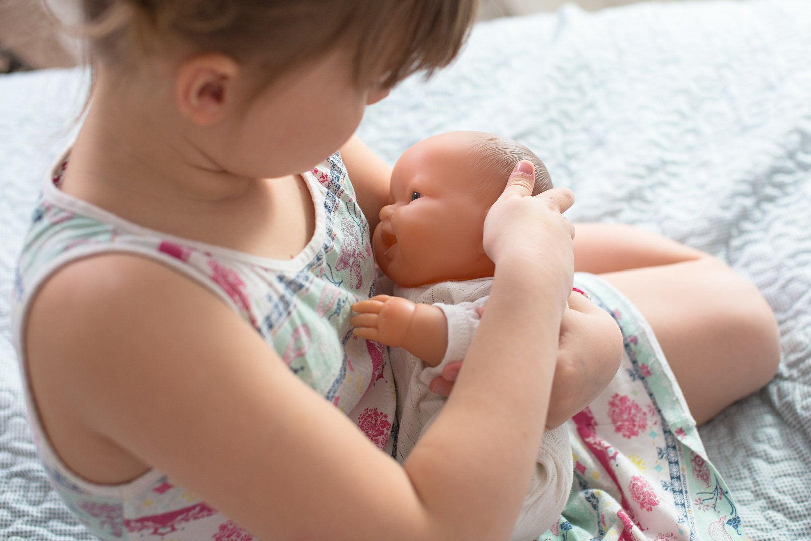 Young Girl Pretend Breastfeeding Baby Doll