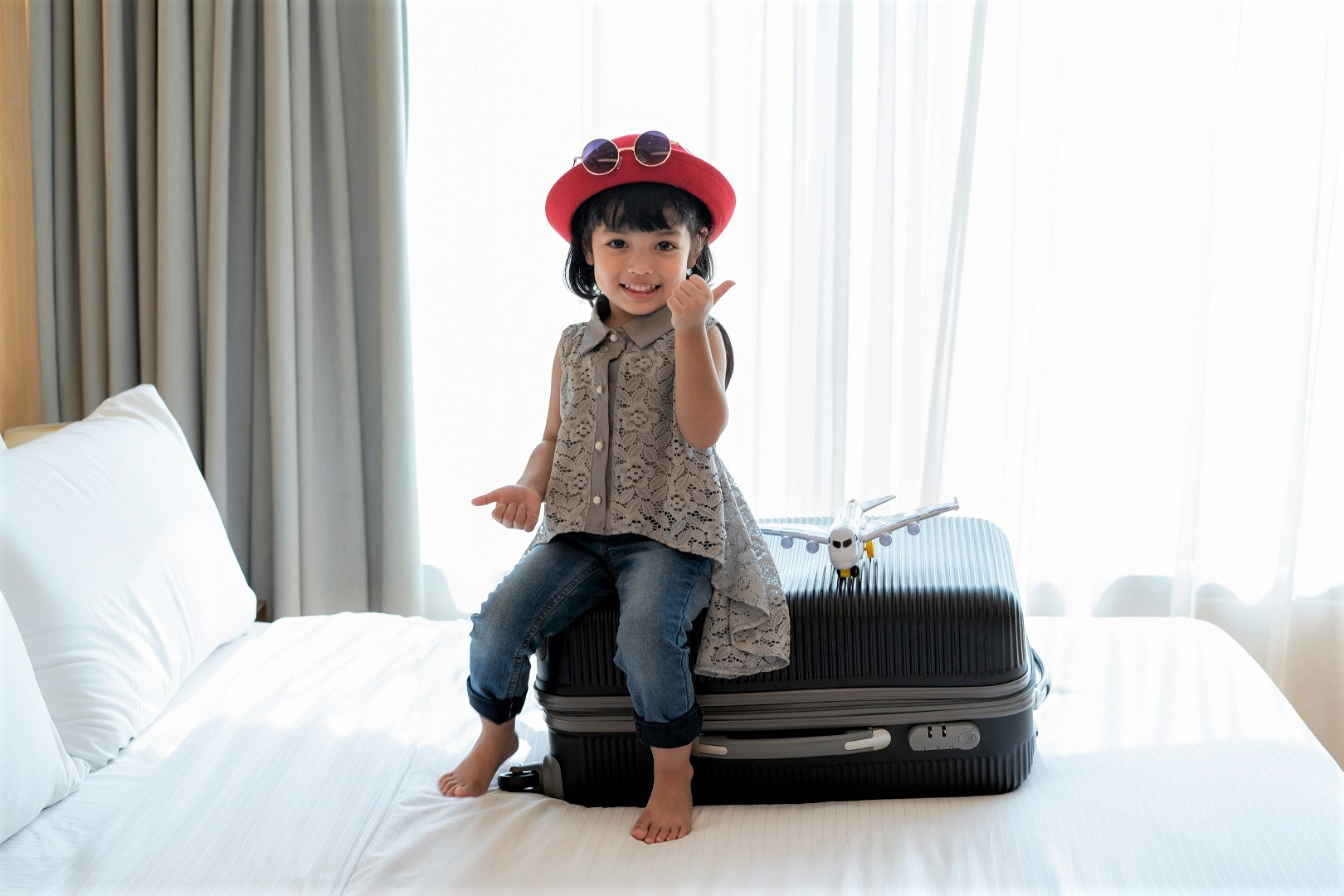 Young Asian Girl Sitting on Luggage Traveling Kids Suitcase