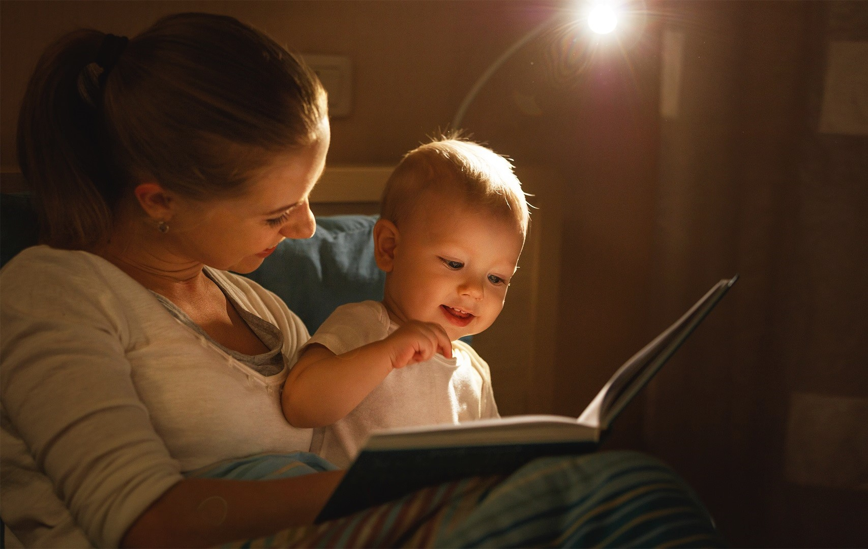 Mother and Baby Reading a Book Dim Light Lamp