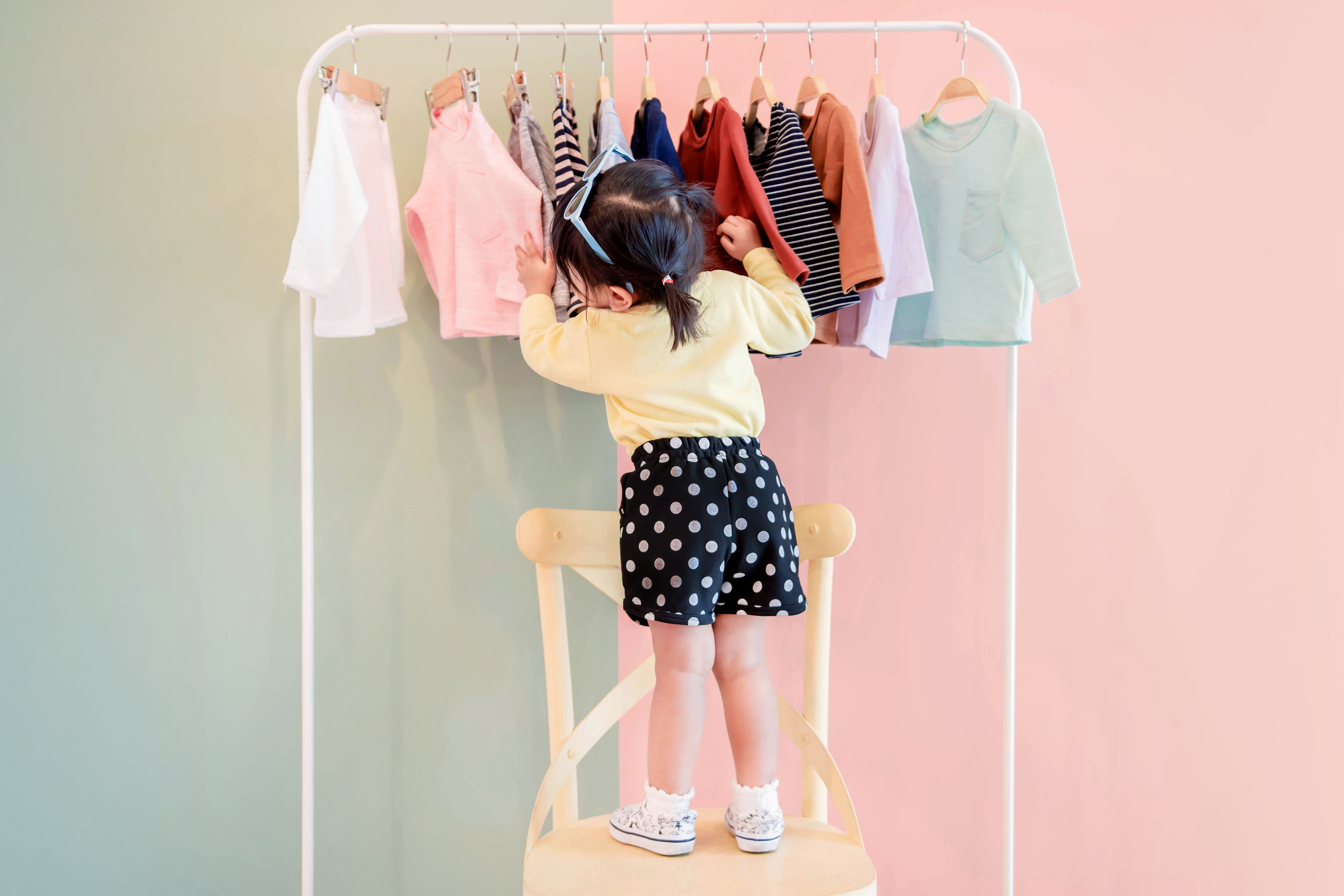 girl with clothing rack