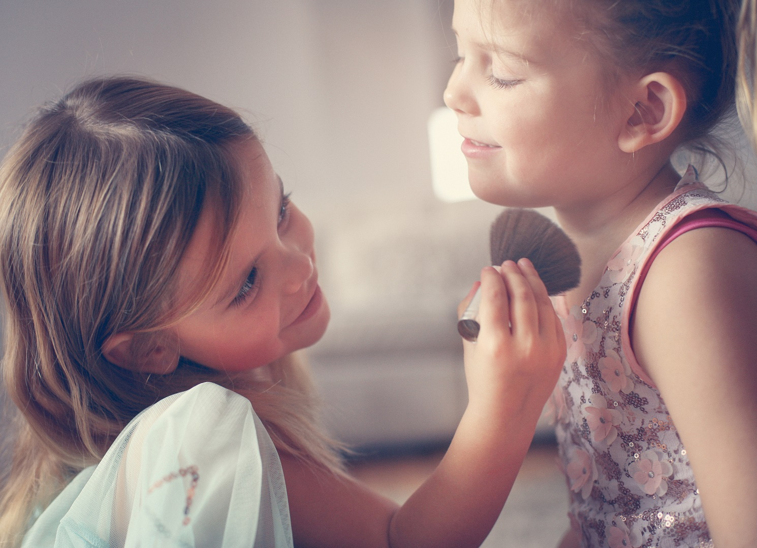 Young Girls Playing with Makeup Powder Brush