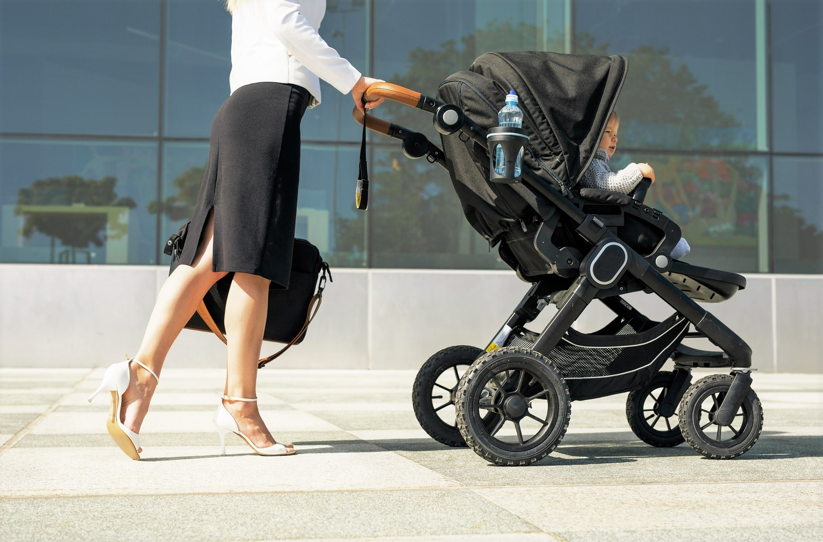 Business Woman Mom Pushing Stroller With Baby