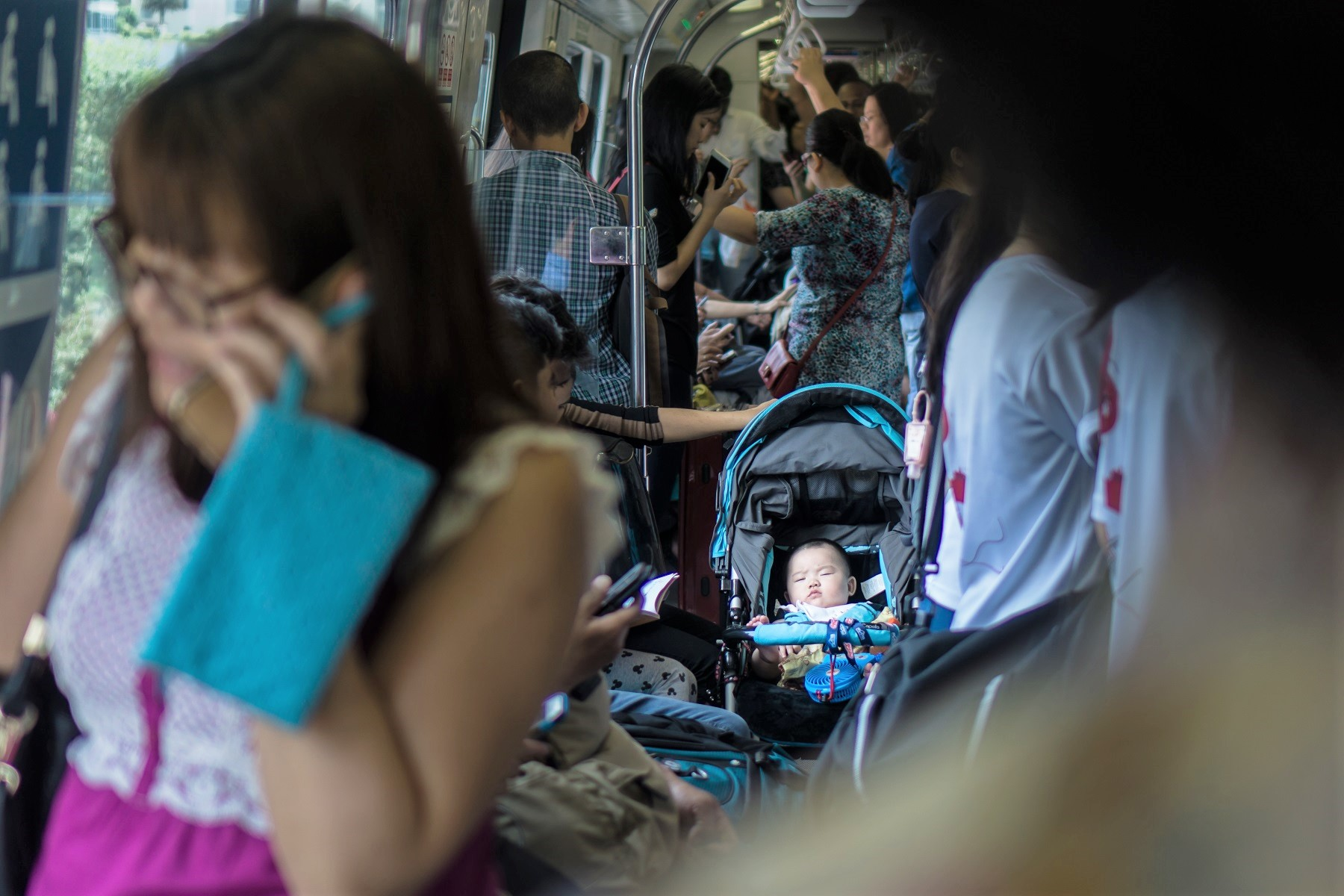 Asian Baby In Stroller Alone on Crowded Train