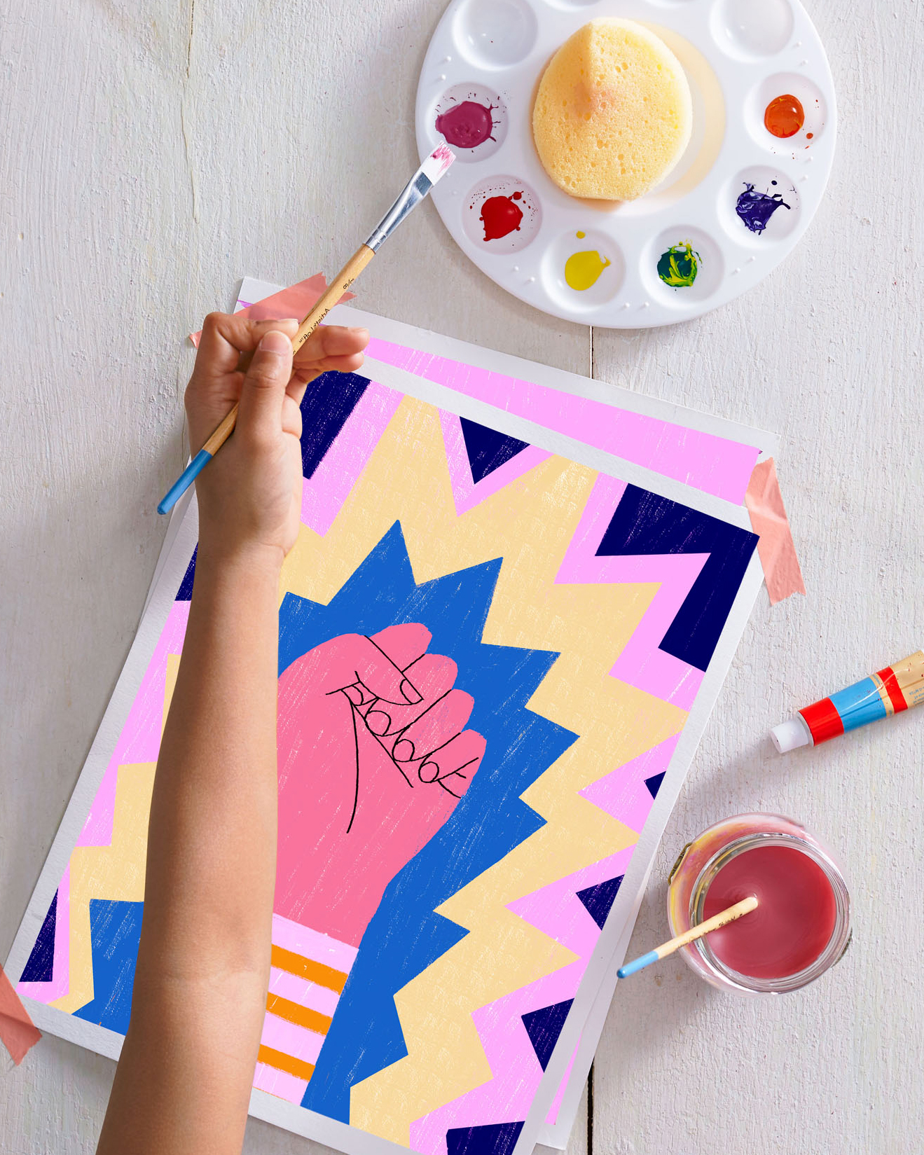 child painting colorful fist image with watercolors on pallet