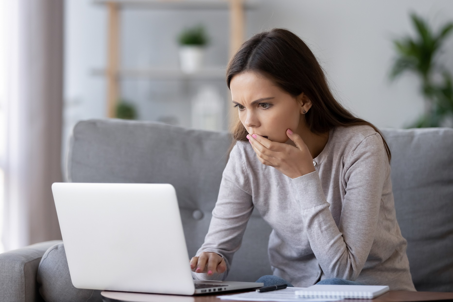 Woman Shocked Looking at Laptop