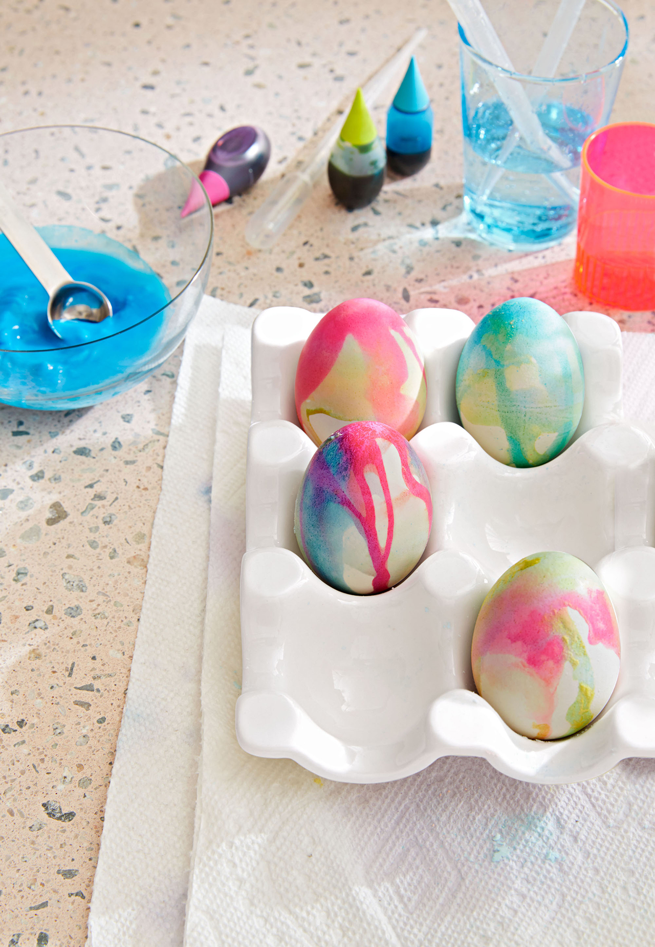 multi-colored easter egg dye in egg carton