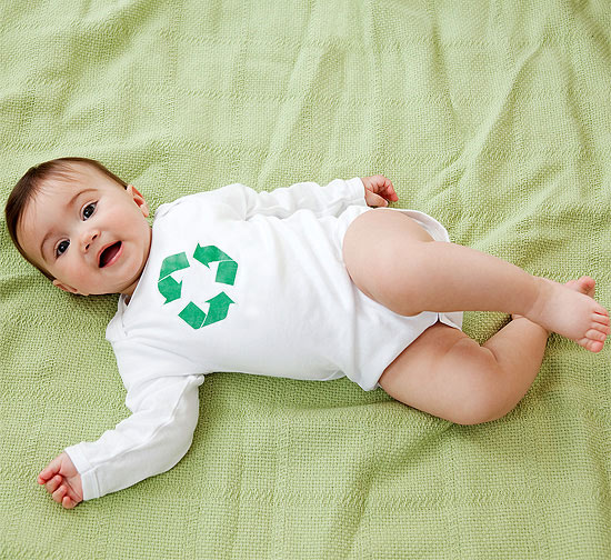 baby in recycle onesie