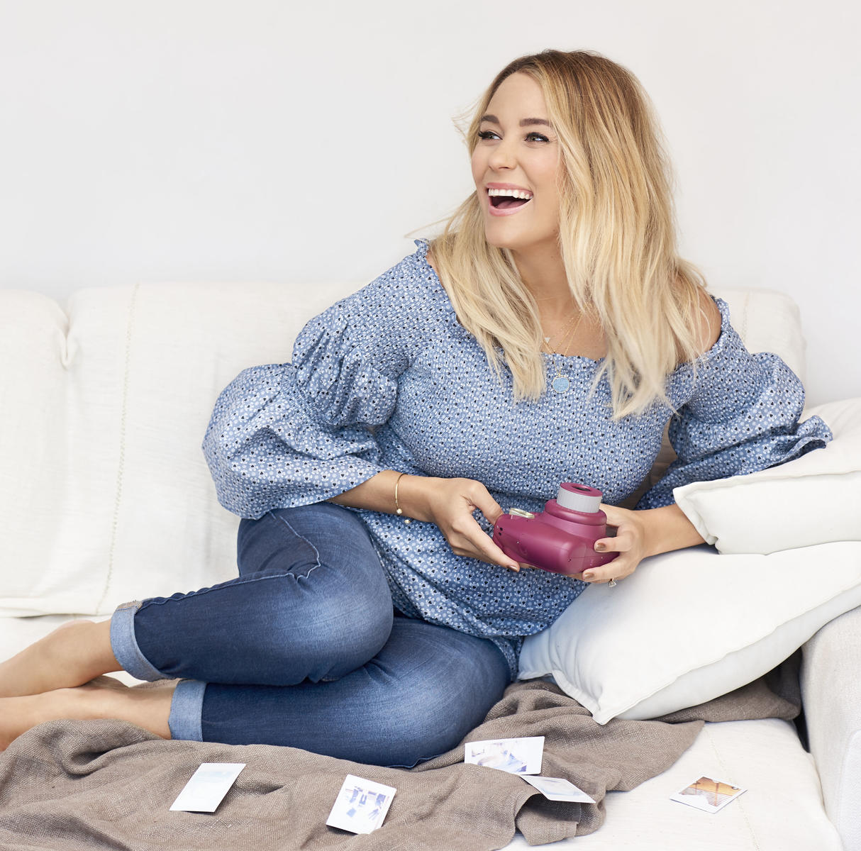 Lauren Conrad Blue Shirt and Pink Polaroid on Couch