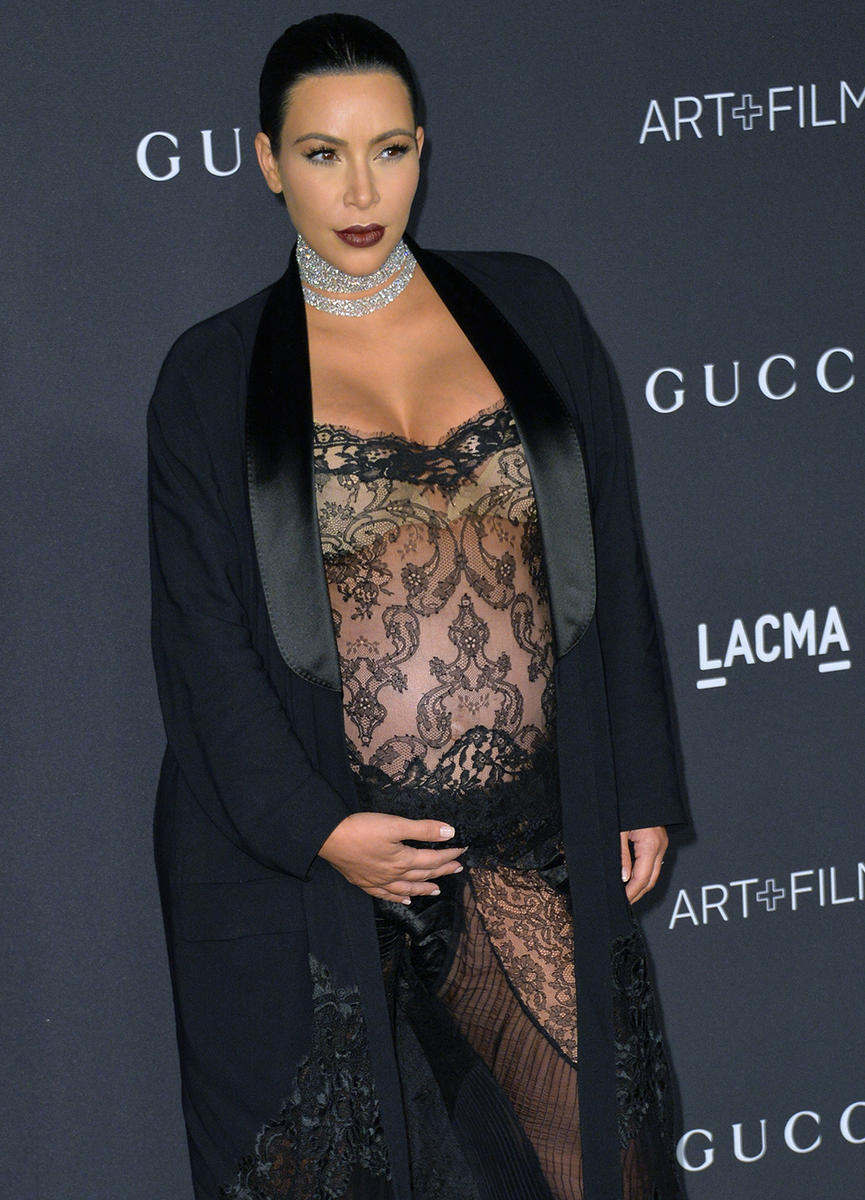 Kim Kardashian pregnant in black lace dress