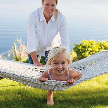 pushing child on hammock