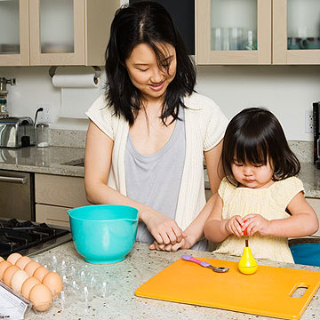 mother cooking with her daughter