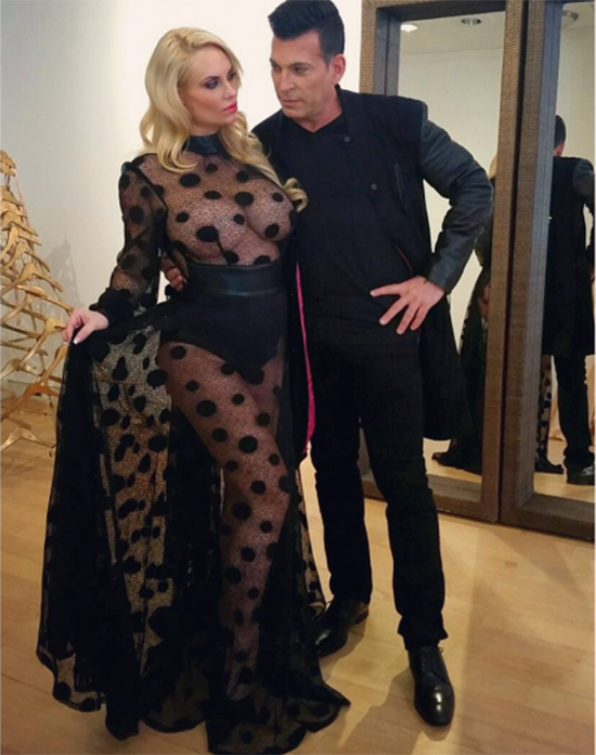pregnant Coco Austin in black lace see-through dress