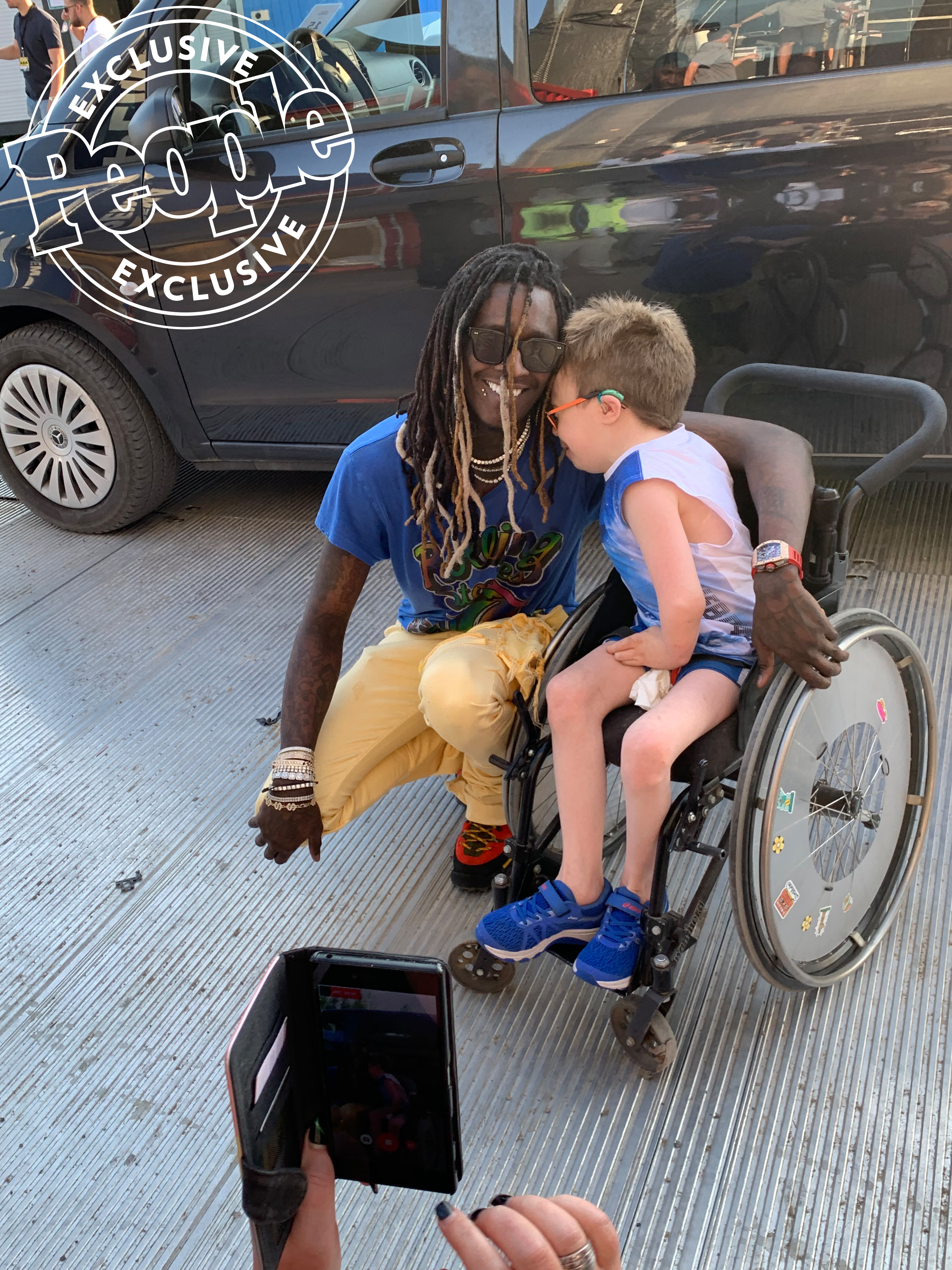 Young Thug and 14 year old fan Steven in Wheel Chair Hug 2