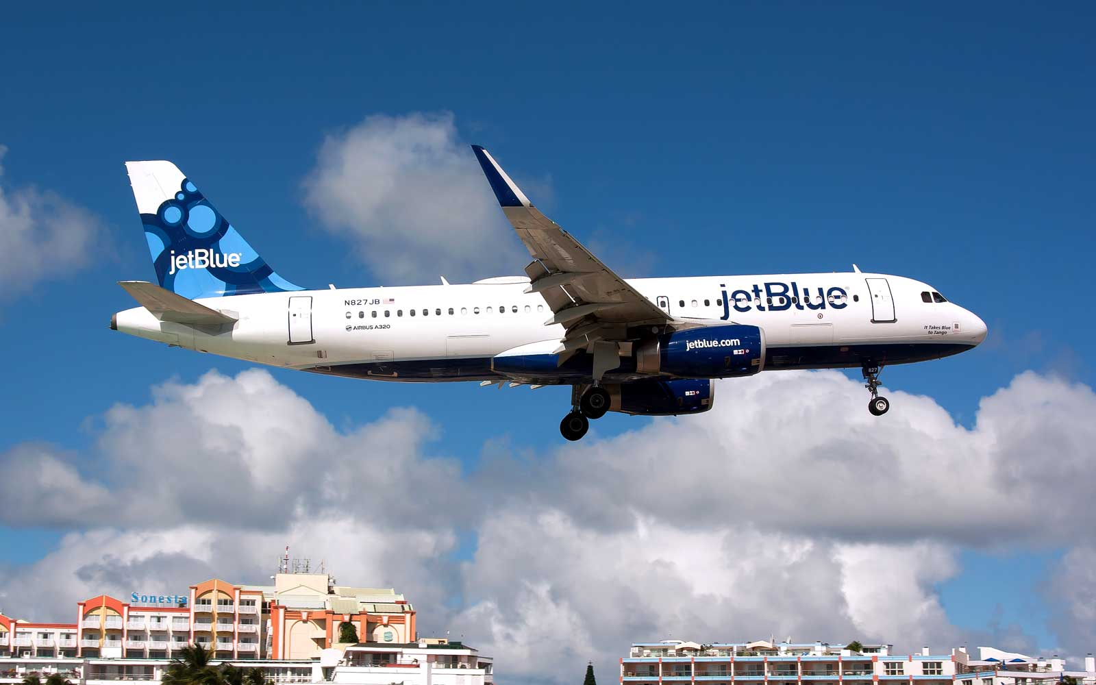 JetBlue Airplane Flying In Sky