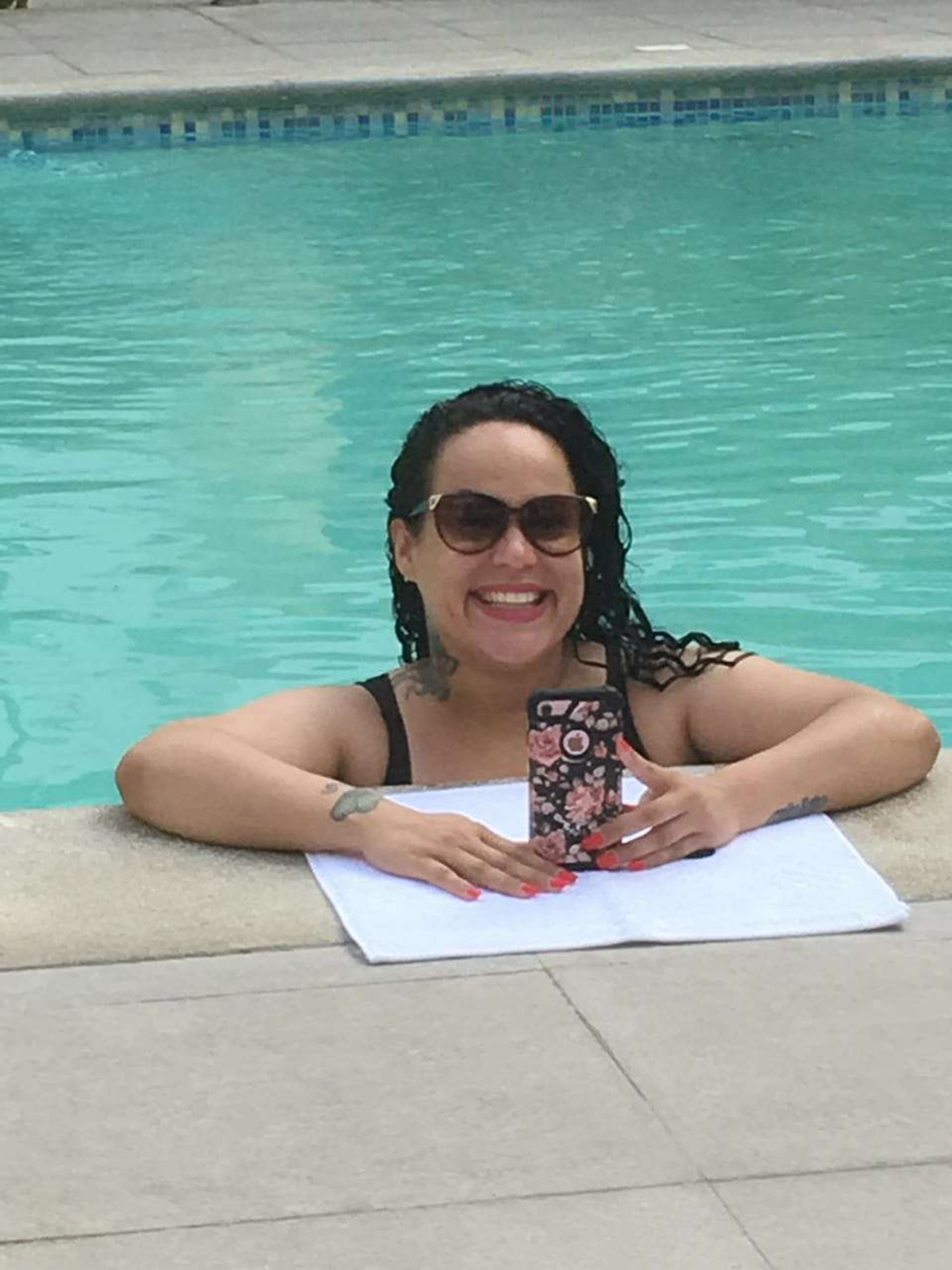 Alexandra Medina In Pool Holding iPhone