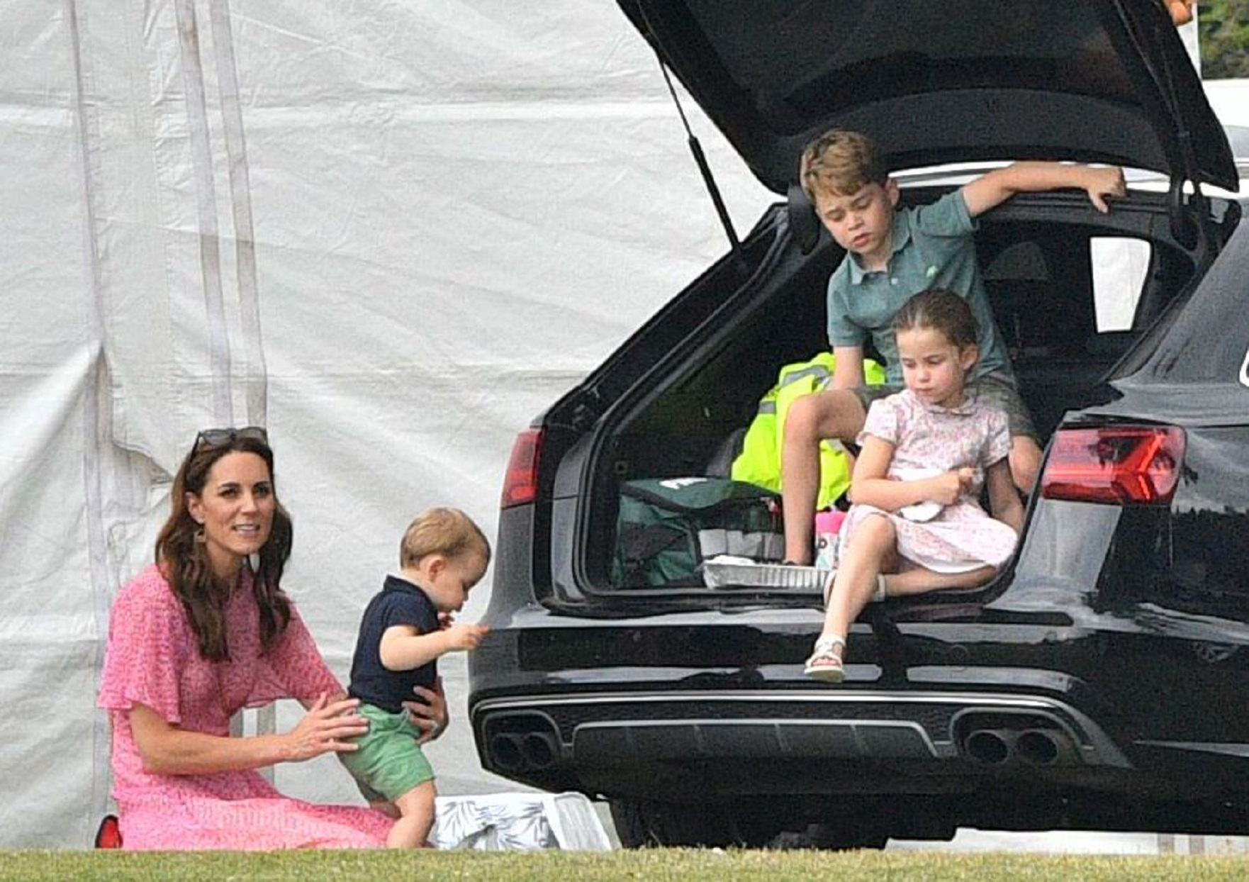 Kate Middleton, Prince Louis, Prince George and Princess Charlotte in Back of Audi Car