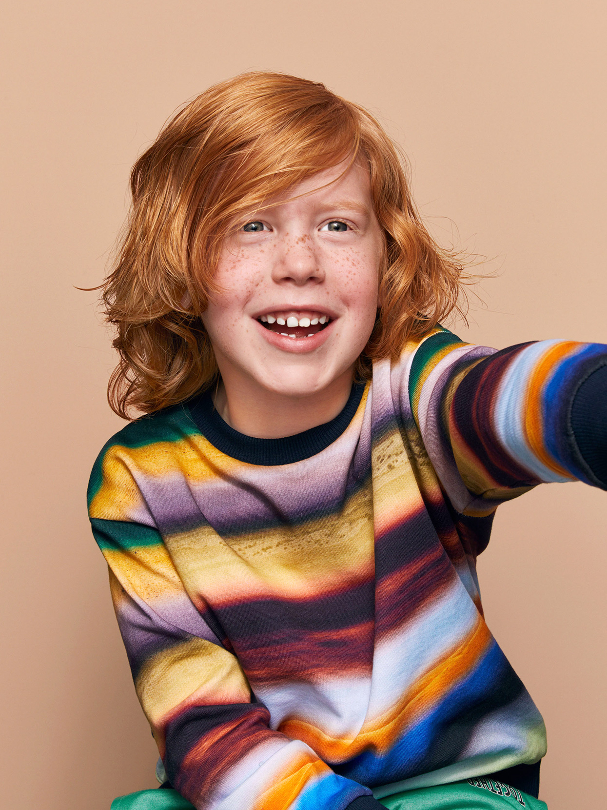 school-aged boy with shaggy-wavy red hair