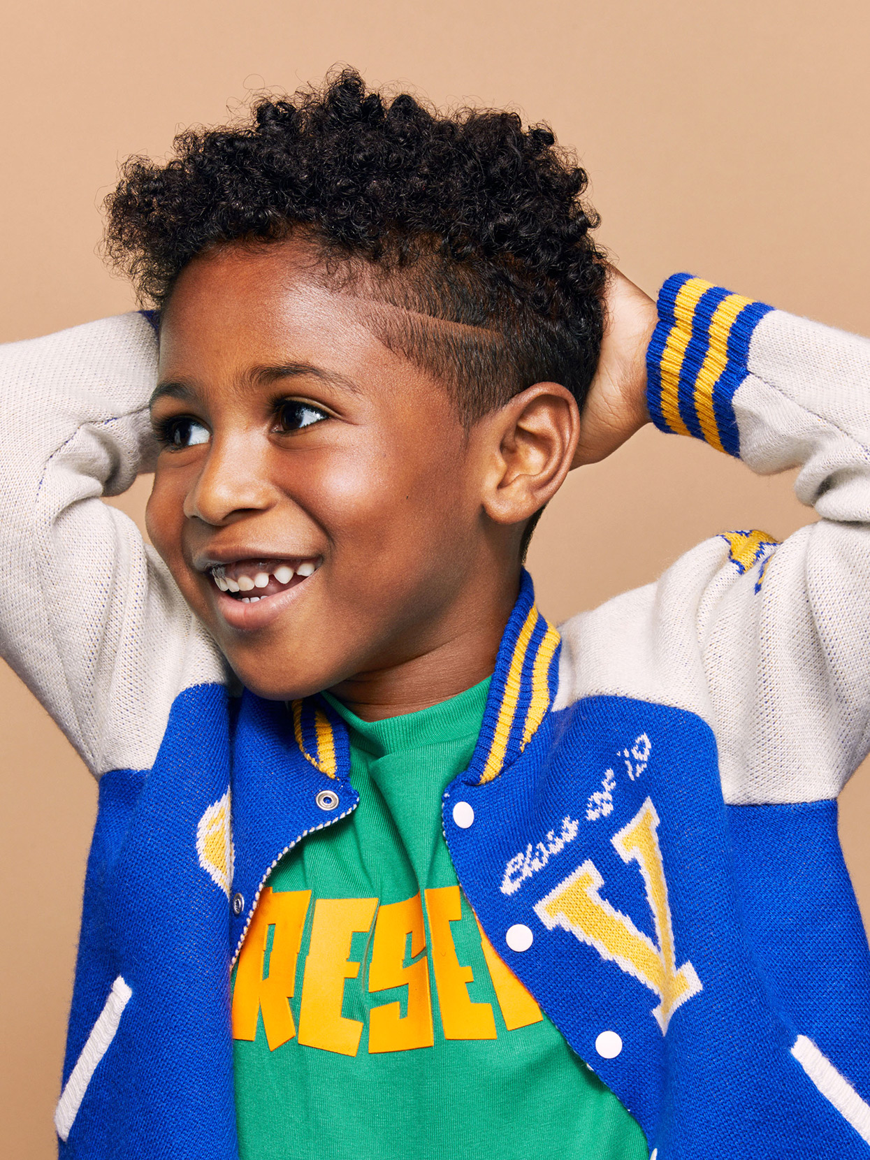 young boy in jacket with fade hairstyle