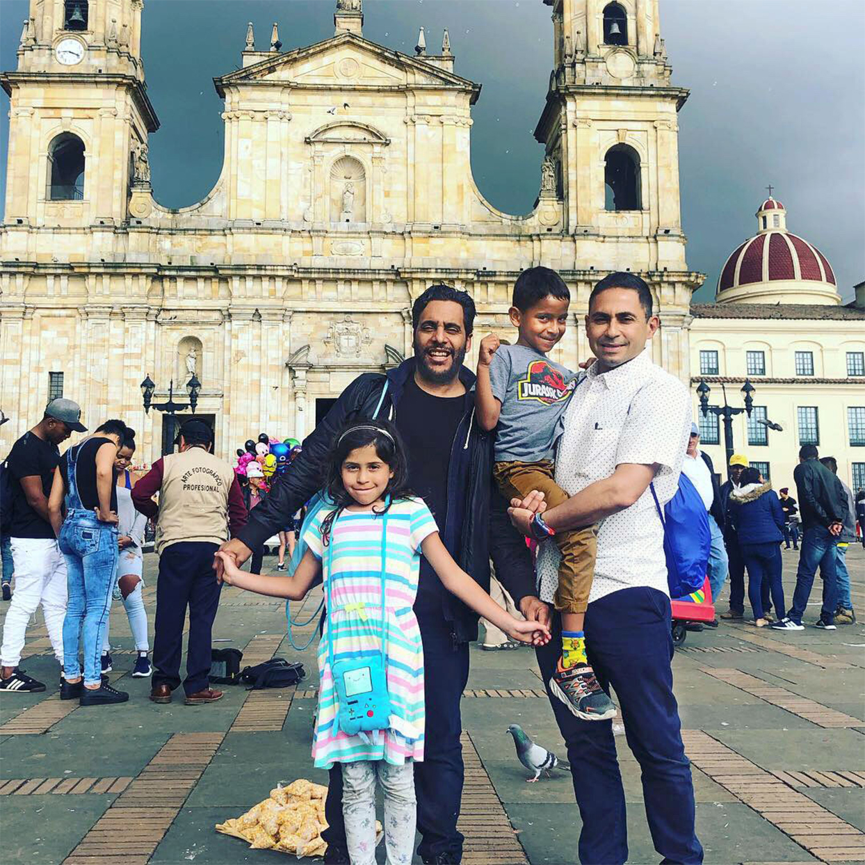 husbands with boy and girl twins in front of historical columbian structure
