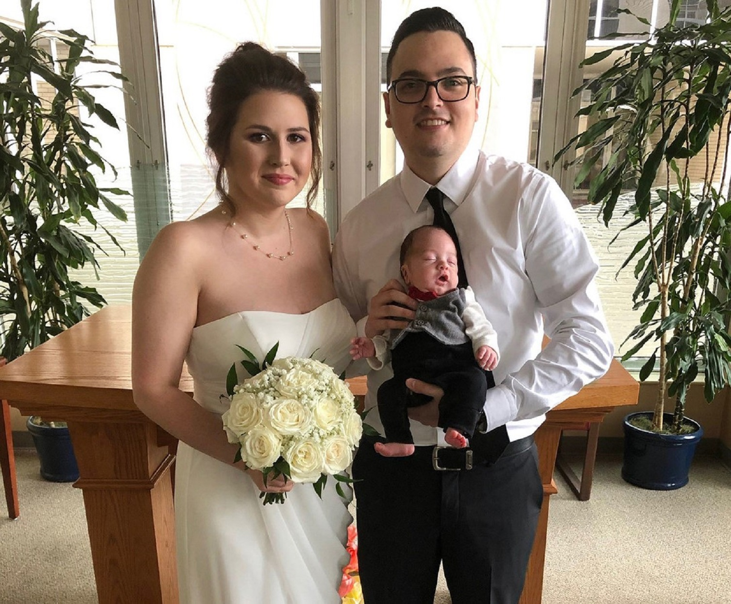 Amanda and Edwin Acevedo Holding Newborn Hospital Wedding 1