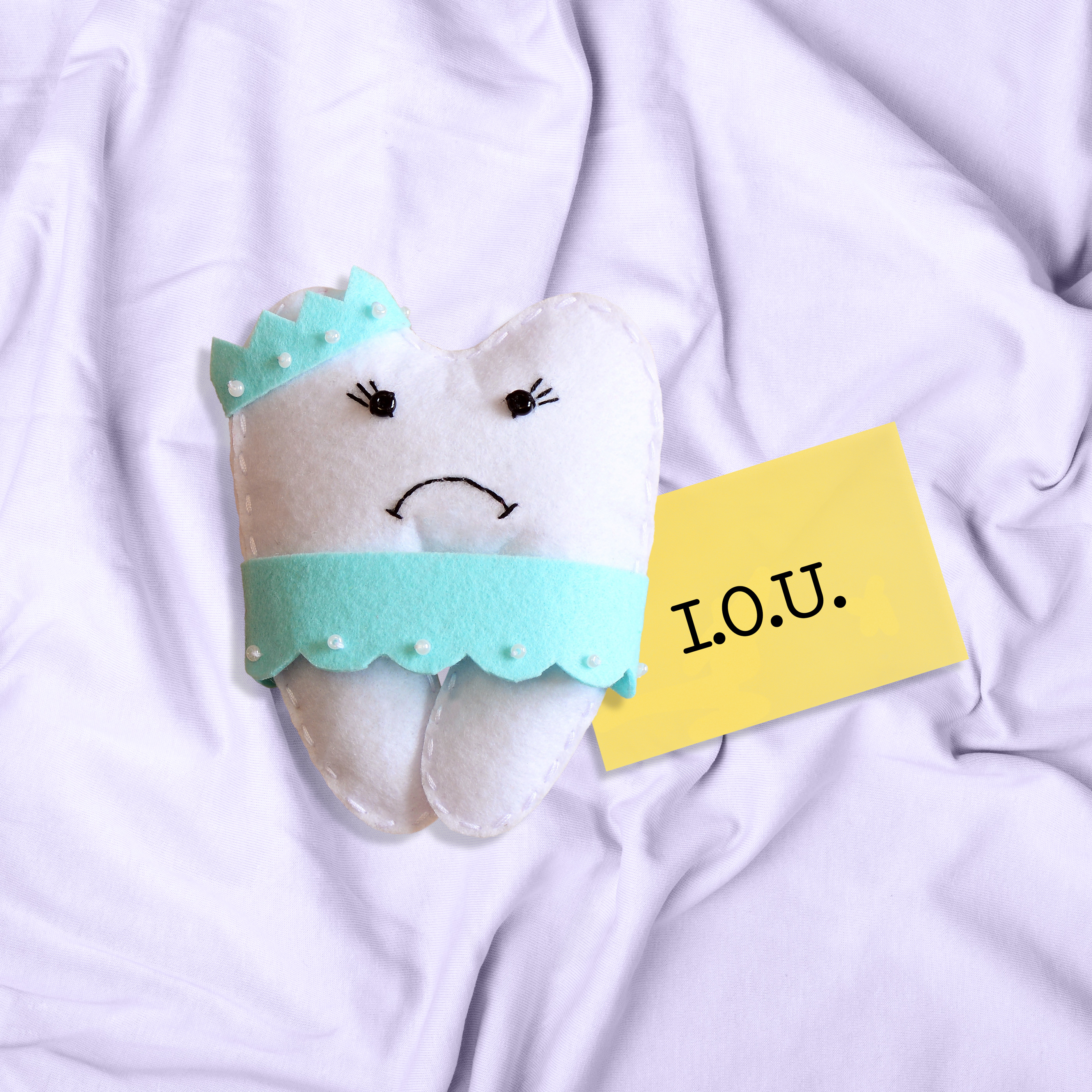 tooth pillow with I.O.U. note