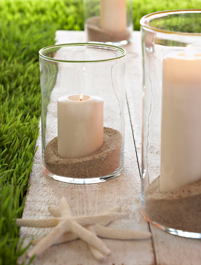 Sand, candles and starfish