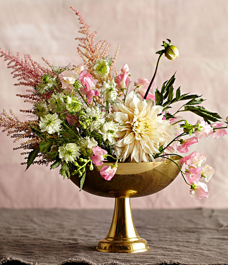 Lushly layered flower arrangement