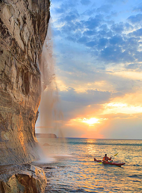 Remote Spray Falls along Pictured Rocks National Lakeshore draws adventurers who love kayaking, mountain biking and hiking.