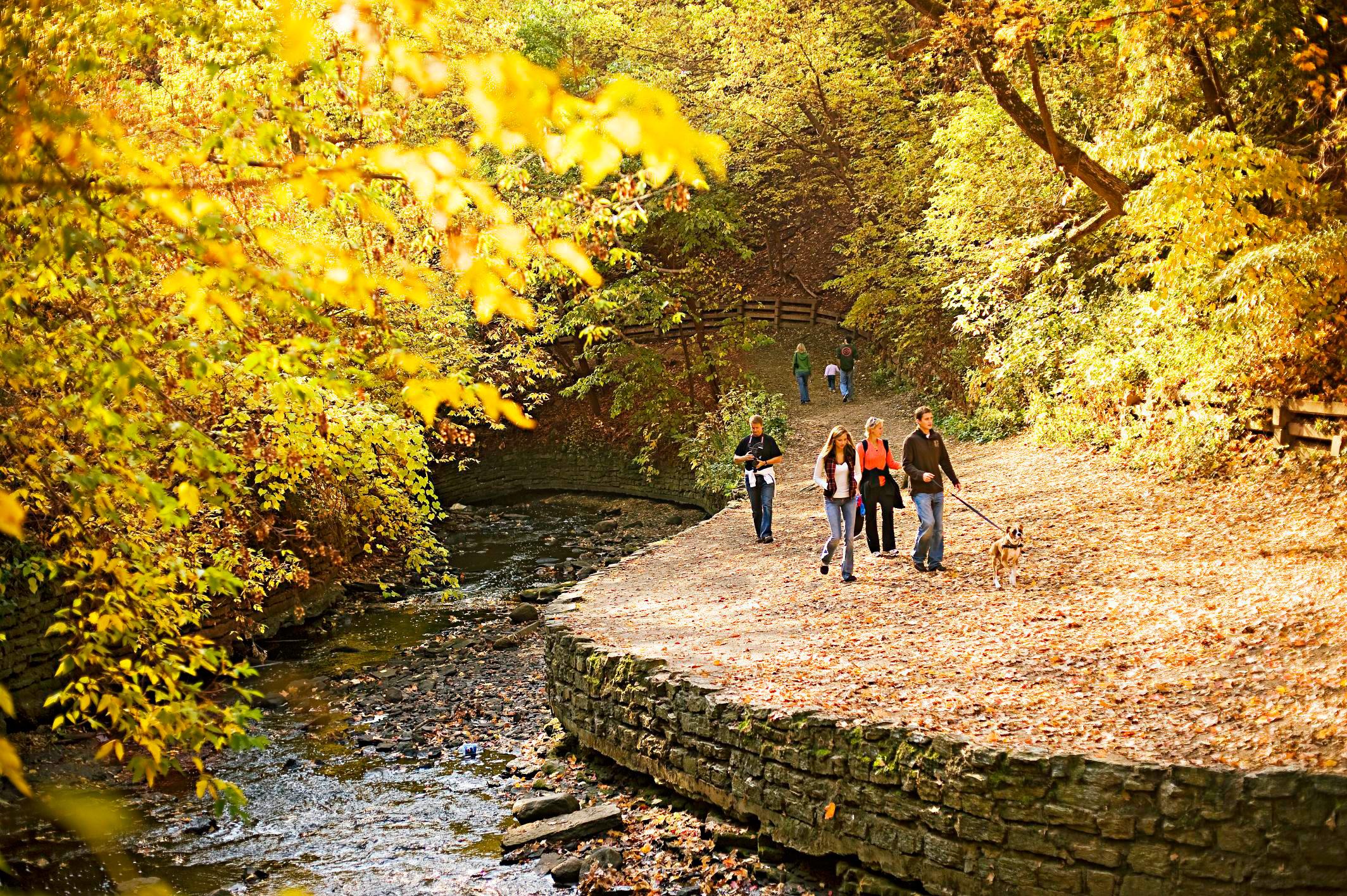 Hikers stroll at Minnehaha Park.
