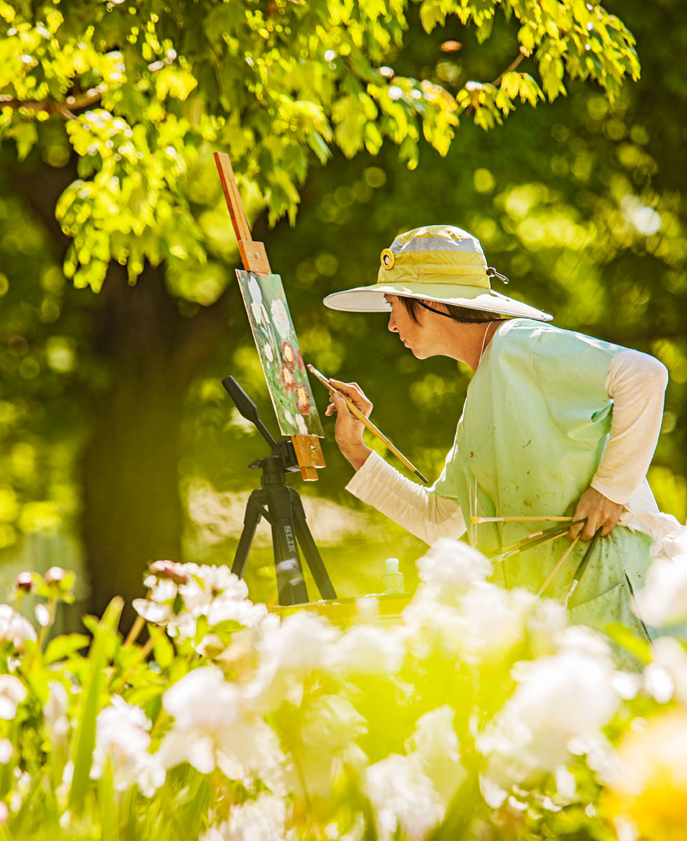 Artist Linda Volz captures flowers on canvas during the annual plein air (open air) art festival in New Harmony, Indiana.