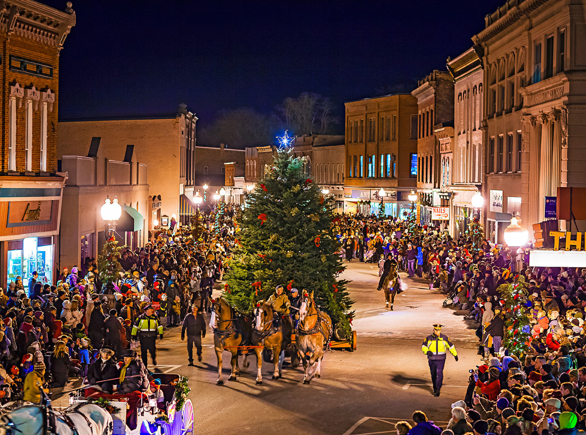 The trees at the parade's end stretch at least 30 feet fall.