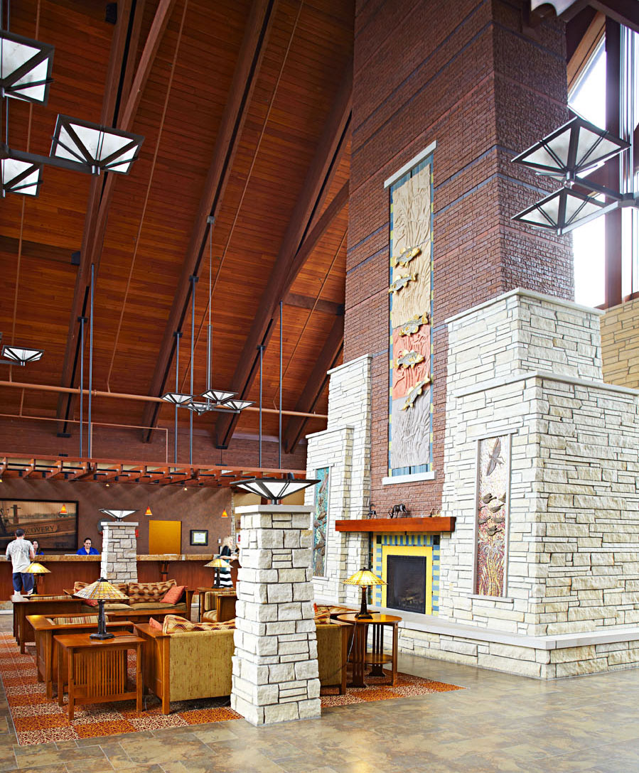 Arts and Crafts design elements, including a towering fireplace, mark Honey Creek Resort State Park.
