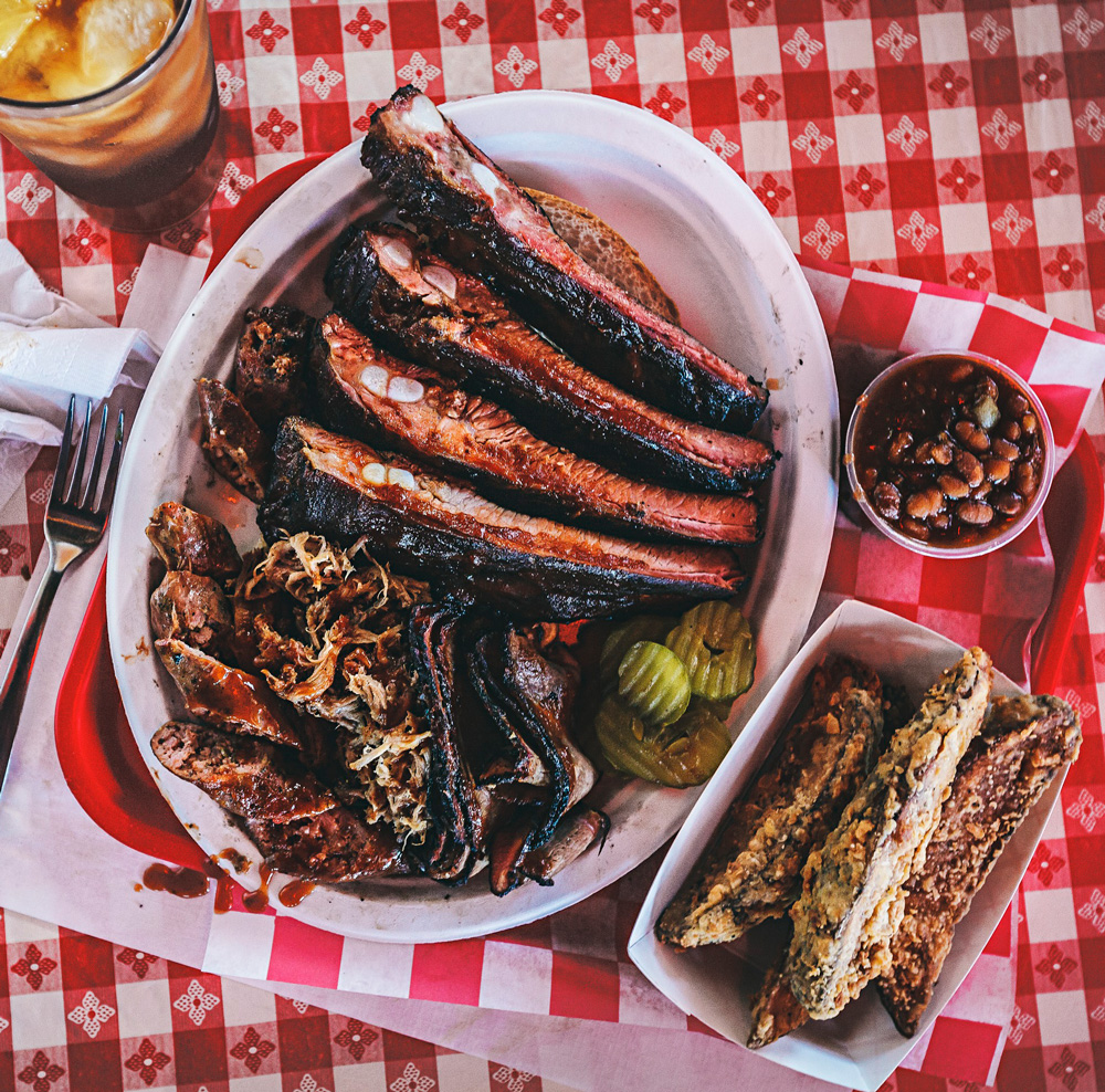 At BB's Lawnside BBQ, the BBQ King Combo includes ribs, Italian sausage, pulled pork, fries and beans.