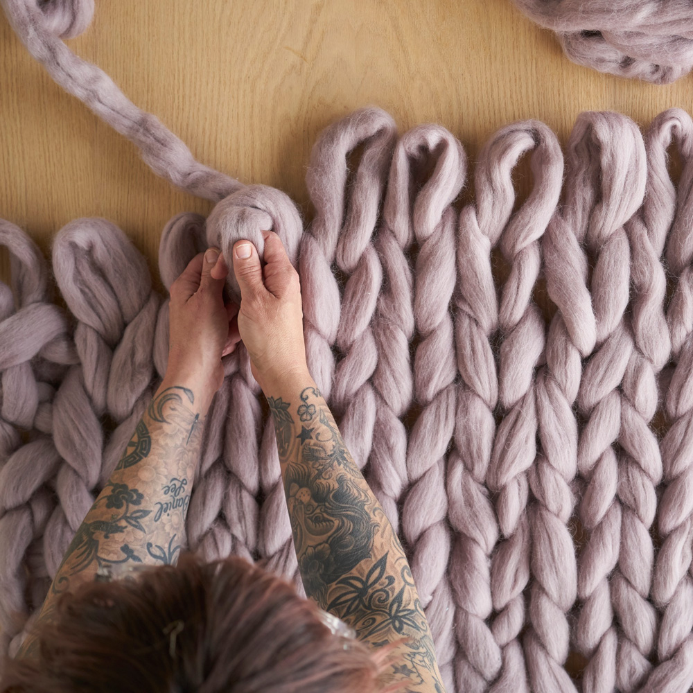 How To Arm-Knit a Comfy Lap Throw
