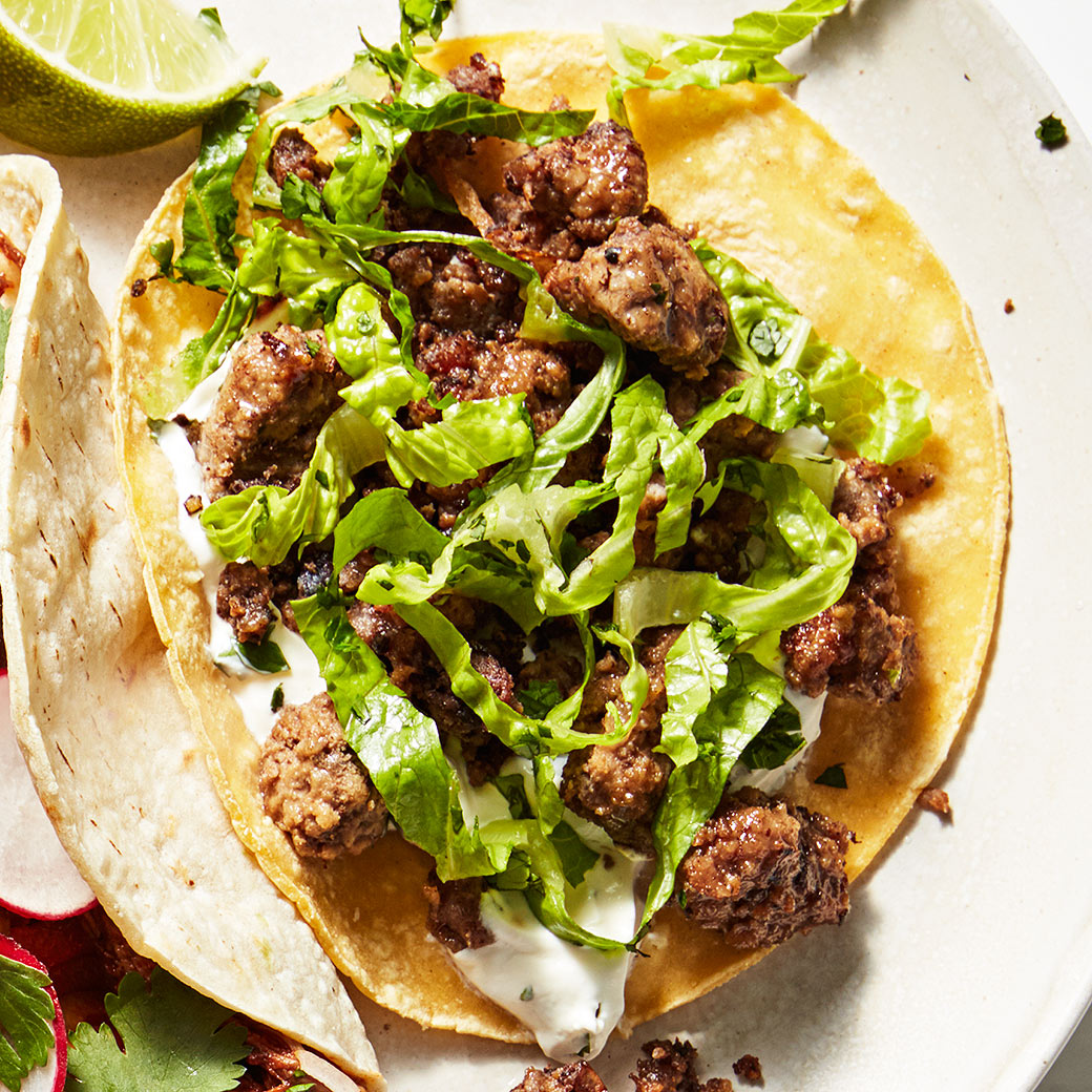 lamb tacos with cilantro-mint crema plate