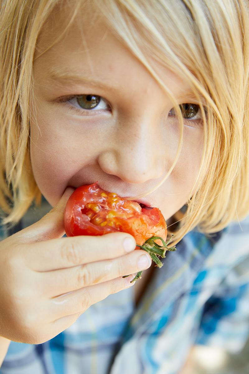 MLife Jan 2018 Foster Family Daughter Eating Tomato