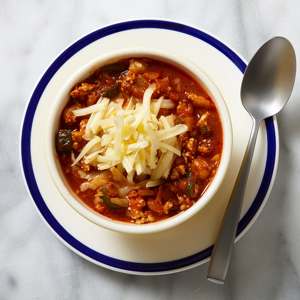 chili in bowl topped with cheese