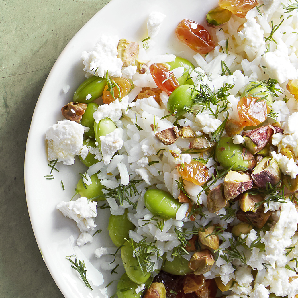 warm rice salad with pistachios on plate