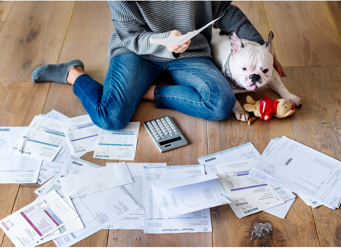 Woman on floor with tax papers