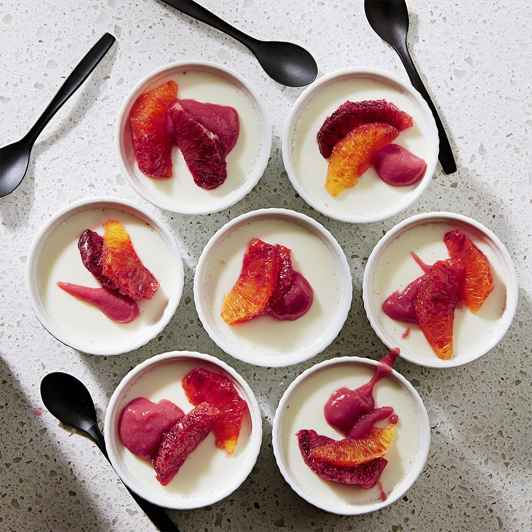 blood oranges and raspberry puree atop vanilla panna cotta